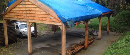 Log Shed Roof Before in Flintshire